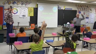 "Al doing ""Safety for the Kids"" presenting in a classroom"
