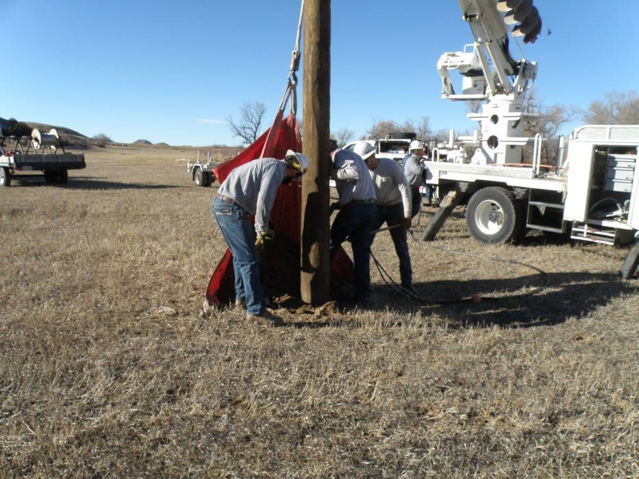 Making sure that the power pole is in the ground very secure